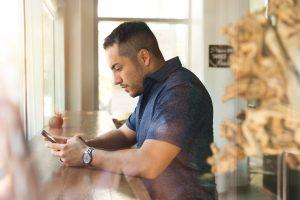 Man using online banking app in Nashville